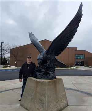 Bruno Niedzweicki poses with the Lake Shore Eagle.