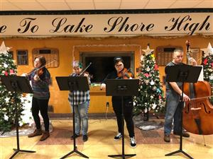 High School Orchestra Students Performs Christmas Carols